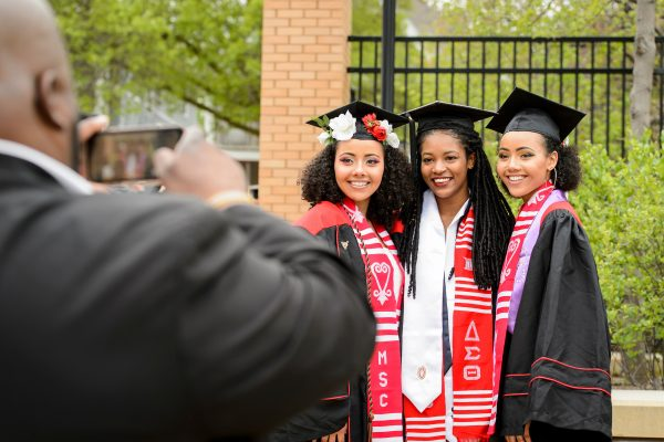 Alexandra Adams, Yanika Davis and Samantha Adams take a group photo before UW-Madison's spring commencement ceremony at Camp Randall Stadium at the University of Wisconsin-Madison on May 12, 2018.
