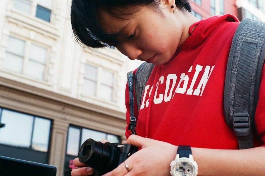 Ariel Yang with a camera