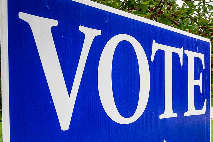 """White letters, blue background: """"VOTE"""""""